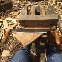 A shingle on the shave horse and the tool we were using.