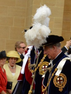 Charles, the Prince of Wales (his plume hiding Prince William)