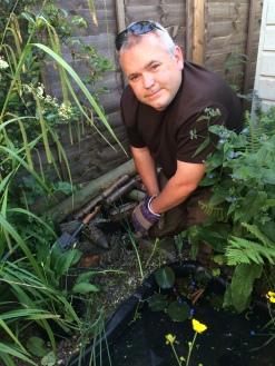 Planting the Echinacea and Lobelia
